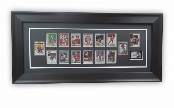 Framing of custom hockey cards with suspension mounting to avoid altering collector's items